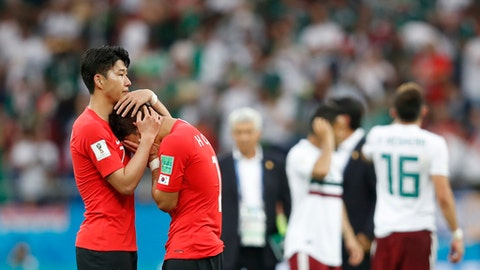 South Korea's Son Heung-min, left, consoles teammate Hwang Hee-chan at the end of the group F match between Mexico and South Korea at the 2018 soccer World Cup in the Rostov Arena in Rostov-on-Don, Russia, Saturday, June 23, 2018. Mexico won 2-1. (AP Photo/Eduardo Verdugo)