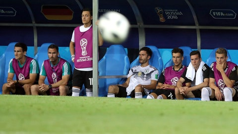 Germany's Mesut Ozil, third from left, looks out from the bench during the group F match between Germany and Sweden at the 2018 soccer World Cup in the Fisht Stadium in Sochi, Russia, Saturday, June 23, 2018. (AP Photo/Thanassis Stavrakis)