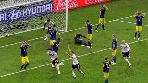 Germany players reacts after their teammate Toni Kroos, scoring his side's second goal during the group F match between Germany and Sweden at the 2018 soccer World Cup in the Fisht Stadium in Sochi, Russia, Saturday, June 23, 2018. (AP Photo/Sergei Grits)