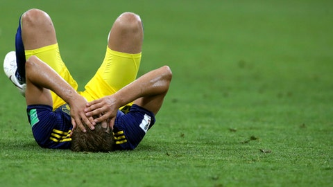 Sweden's Ludwig Augustinsson holds his head as he lies on the pitch at the end of the group F match between Germany and Sweden at the 2018 soccer World Cup in the Fisht Stadium in Sochi, Russia, Saturday, June 23, 2018. Germany won 2-1. (AP Photo/Thanassis Stavrakis)
