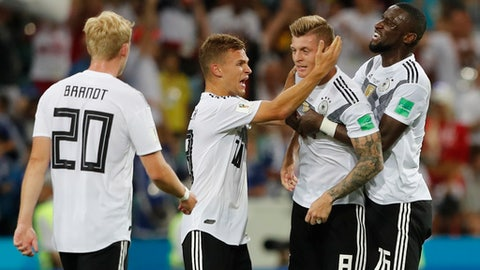 From left, Germany's Julian Brandt, Joshua Kimmich, Toni Kroos and Antonio Ruediger celebrate their team's 2-1 victory at the of the group F match between Germany and Sweden at the 2018 soccer World Cup in the Fisht Stadium in Sochi, Russia, Saturday, June 23, 2018. (AP Photo/Frank Augstein)