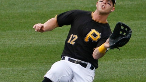 Pittsburgh Pirates left fielder Corey Dickerson makes a sliding catch on a fly ball by Arizona Diamondbacks' Jeff Mathis for the third out of the third inning of a baseball game Saturday, June 23, 2018, in Pittsburgh. (AP Photo/Keith Srakocic)