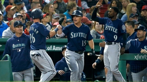 Seattle Mariners' Chris Herrmann (26) celebrates with teammates Kyle Seager (15) and Dee Gordon (9) after scoring on a two-run double by Mitch Haniger during the fourth inning of a baseball game against the Boston Red Sox in Boston, Saturday, June 23, 2018. (AP Photo/Michael Dwyer)