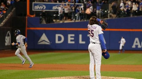 New York Mets pitcher Robert Gsellman (65) reacts after giving up a grand slam to Los Angeles Dodgers' Matt Kemp during the eighth inning of a baseball game, Saturday, June 23, 2018, in New York. (AP Photo/Julie Jacobson)