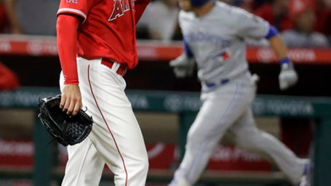 Toronto Blue Jays' Steve Pearce rounds the bases on a three-run home run off Los Angeles Angels relief pitcher Justin Anderson during the ninth inning of a baseball game in Anaheim, Calif., Saturday, June 23, 2018. (AP Photo/Chris Carlson)