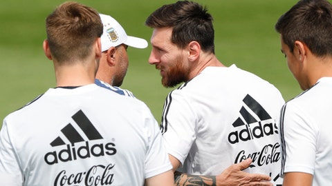 Lionel Messi is congratulated by coach Jorge Sampaoli on the day of his birthday during a training session of Argentina at the 2018 soccer World Cup in Bronnitsy, Russia, Sunday, June 24, 2018. (AP Photo/Ricardo Mazalan)