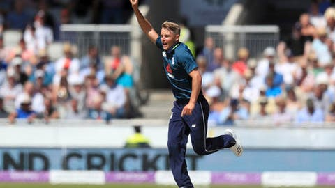 England's Sam Curran celebrates taking the wicket of Australia's Ashton Agar, during the One Day International match between England and Australia, at Emirates Old Trafford, in Manchester, England, Sunday, June 24, 2018. (Mike Egerton/PA via AP)