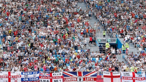 England flags are seen as fans watch the group G match between England and Panama at the 2018 soccer World Cup at the Nizhny Novgorod Stadium in Nizhny Novgorod , Russia, Sunday, June 24, 2018. (AP Photo/Antonio Calanni)