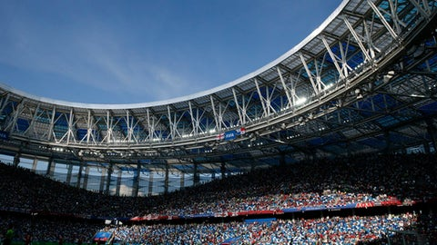 The sun casts a shadow at the Nizhny Novgorod Stadium during the group G match between England and Panama at the 2018 soccer World Cup in Nizhny Novgorod , Russia, Sunday, June 24, 2018. (AP Photo/Alastair Grant)