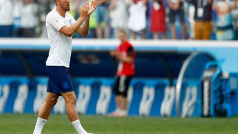England's Harry Kane reacts to his team's supporters following their group G match 6-1 win over Panama at the 2018 soccer World Cup at the Nizhny Novgorod Stadium in Nizhny Novgorod , Russia, Sunday, June 24, 2018. (AP Photo/Matthias Schrader)