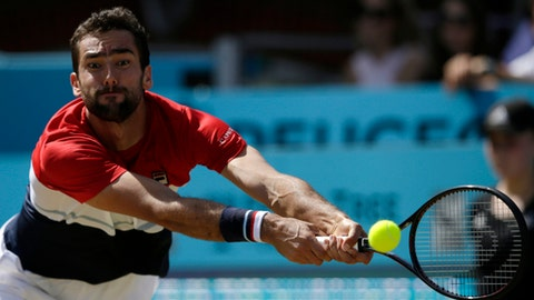 Croatia's Marin Cilic returns to Serbia's Novak Djokovic during the final tennis match at the Queen's Club tennis tournament in London, Sunday, June 24, 2018. (AP Photo/Tim Ireland)