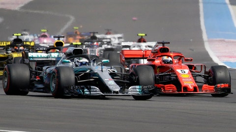 Mercedes driver Valtteri Bottas of Finland, left and Ferrari driver Sebastian Vettel of Germany take a curve together during the French Formula One Grand Prix at the Paul Ricard racetrack, in Le Castellet, southern France, Sunday, June 24, 2018. (AP Photo/Claude Paris)