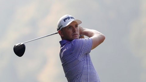 Matt Wallace, of Britain, hits the ball during the 74th Italy Open Golf tournament in Monza, Italy, Saturday, Oct. 14, 2017. (AP Photo/Antonio Calanni)