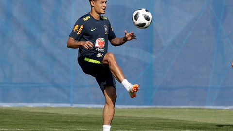 Brazil's Philippe Coutinho practices during a training session, in Sochi, Russia, Sunday, June 24, 2018. Brazil will face Serbia on June 27 in the group E for the soccer World Cup. (AP Photo/Andre Penner)