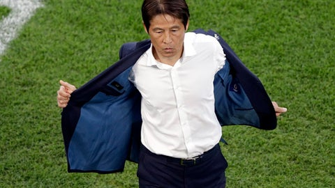 Japan's head coach Akira Nishino takes off his jacket during the group H match between Japan and Senegal at the 2018 soccer World Cup at the Yekaterinburg Arena in Yekaterinburg , Russia, Sunday, June 24, 2018. (AP Photo/Mark Baker )