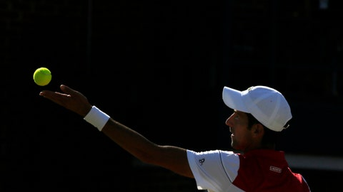 Serbia's Novak Djokovic prepares to serve to Croatia's Marin Cilic during the final tennis match at the Queen's Club tennis tournament in London, Sunday, June 24, 2018. (AP Photo/Tim Ireland)