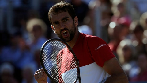 Croatia's Marin Cilic celebrates breaking the serve of Serbia's Novak Djokovic during the final tennis match at the Queen's Club tennis tournament in London, Sunday, June 24, 2018. (AP Photo/Tim Ireland)