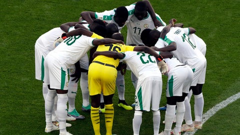 Senegal team embrace prior to the group H match between Japan and Senegal at the 2018 soccer World Cup at the Yekaterinburg Arena in Yekaterinburg , Russia, Sunday, June 24, 2018. (AP Photo/Mark Baker )