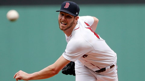 Boston Red Sox starting pitcher Chris Sale delivers against the Seattle Mariners during the first inning of a baseball game at Fenway Park in Boston Sunday, June 24, 2018. (AP Photo/Winslow Townson)