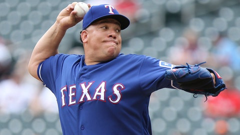 Texas Rangers pitcher Bartolo Colon throws against the Minnesota Twins in the first inning of a baseball game Sunday, June 24, 2018, in Minneapolis. (AP Photo/Stacy Bengs)