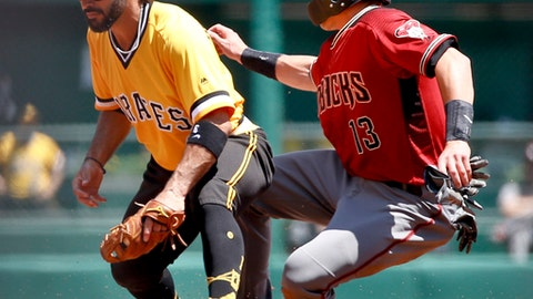 Arizona Diamondbacks' Nick Ahmed (13) is forced out at second after a tag by Pittsburgh Pirates' Sean Rodriguez on a bunt by Clay Buchholz in the second inning of a baseball game, Sunday, June 24, 2018, in Pittsburgh. (AP Photo/Keith Srakocic)