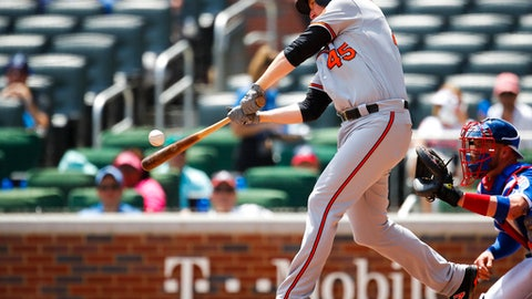 Baltimore Orioles pinch hitter Mark Trumbo (45) hits a two run home run in the fifth inning of a baseball game against the Atlanta Braves, Sunday, June 24, 2018, in Atlanta. (AP Photo/Todd Kirkland)