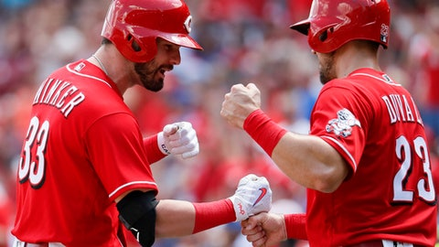 Cincinnati Reds' Jesse Winker (33) celebrates with Adam Duvall (23) after hitting a three-run home run off Chicago Cubs relief pitcher Pedro Strop in the seventh inning of a baseball game, Sunday, June 24, 2018, in Cincinnati. (AP Photo/John Minchillo)