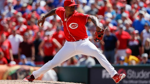 Cincinnati Reds relief pitcher Raisel Iglesias throws in the ninth inning of a baseball game against the Chicago Cubs, Sunday, June 24, 2018, in Cincinnati. (AP Photo/John Minchillo)