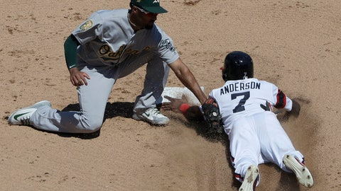 Oakland Athletics shortstop Marcus Semien, left, tags out Chicago White Sox's Tim Anderson at second during the fifth inning of a baseball game Sunday, June 24, 2018, in Chicago. (AP Photo/Nam Y. Huh)