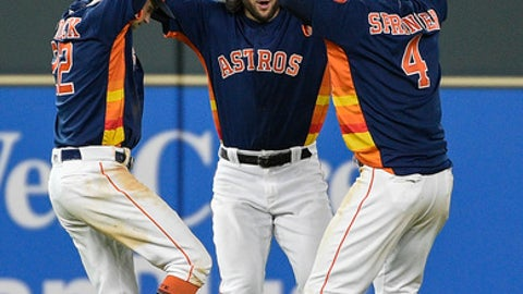 Houston Astros' Josh Reddick, left, Jake Marisnick, center, and George Springer celebrate the team's win against the Kansas City Royals in a baseball game, Sunday, June 24, 2018, in Houston. (AP Photo/Eric Christian Smith)