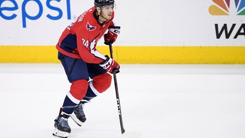 File- This May 17, 2018, file photo shows Washington Capitals defenseman John Carlson (74) skating with the puck during the third period of Game 4 of the NHL Eastern Conference finals hockey playoff series against the Tampa Bay Lightning in Washington. A person with knowledge of the move says the Capitals have re-signed Carlson to a $64 million, eight-year contract. The person spoke to The Associated Press on condition of anonymity Sunday, June 24, 2018, because the deal hadnt yet been announced. (AP Photo/Nick Wass, File)