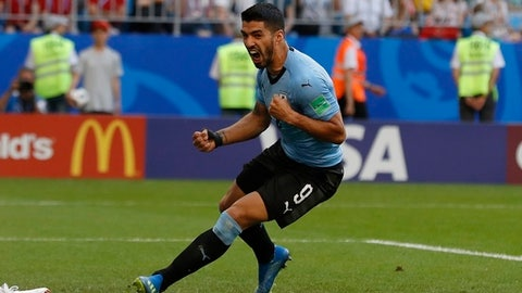 Uruguay's Luis Suarez celebrates the second goal of his team during the group A match between Uruguay and Russia at the 2018 soccer World Cup at the Samara Arena in Samara, Russia, Monday, June 25, 2018. (AP Photo/Rebecca Blackwell)