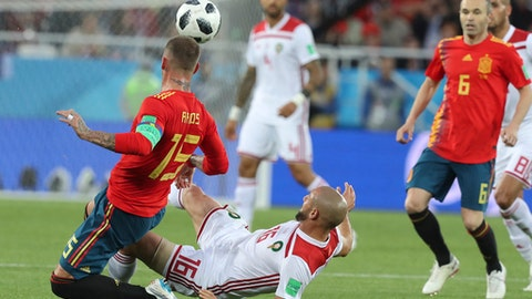 Spain's Sergio Ramos, left, vies for the ball with Morocco's Noureddine Amrabat during the group B match between Spain and Morocco at the 2018 soccer World Cup at the Kaliningrad Stadium in Kaliningrad, Russia, Monday, June 25, 2018. (AP Photo/Czarek Sokolowski)