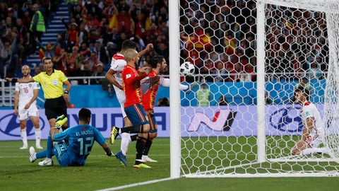 Spain's Isco, center background, celebrates after scoring his side's opening goal during the group B match between Spain and Morocco at the 2018 soccer World Cup at the Kaliningrad Stadium in Kaliningrad, Russia, Monday, June 25, 2018. (AP Photo/Manu Fernandez)