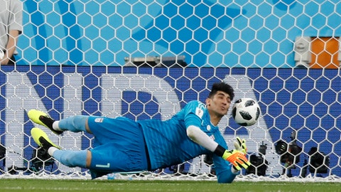 Iran goalkeeper Ali Beiranvand makes a save during the group B match between Iran and Portugal at the 2018 soccer World Cup at the Mordovia Arena in Saransk, Russia, Monday, June 25, 2018. (AP Photo/Pavel Golovkin)