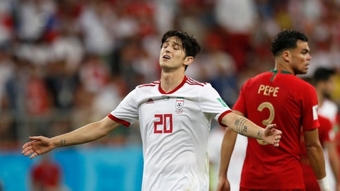 Iran's Sardar Azmoun reacts during the group B match between Iran and Portugal at the 2018 soccer World Cup at the Mordovia Arena in Saransk, Russia, Monday, June 25, 2018. (AP Photo/Pavel Golovkin)