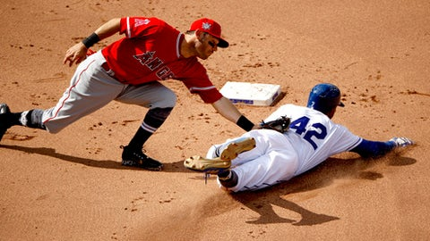 Kansas City Royals' Rosell Herrera is caught stealing second by Los Angeles Angels second baseman Ian Kinsler to end the sixth inning of a baseball game Monday, June 25, 2018, in Kansas City, Mo. (AP Photo/Charlie Riedel)