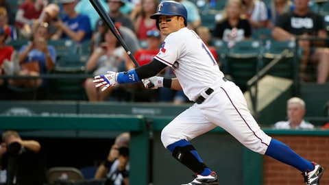 Texas Rangers right fielder Shin-Soo Choo (17) singles against the San Diego Padres during the third inning of a baseball game Monday, June 25, 2018, in Arlington, Texas. (AP Photo/Ron Jenkins)