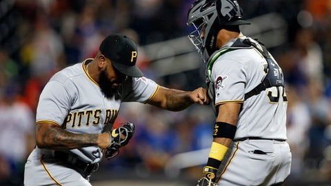 Pittsburgh Pirates pitcher Felipe Vazquez celebrates with Pirates catcher Elias Diaz after defeating the New York Mets 6-4 in a baseball game on Monday, June 25, 2018, in New York. (AP Photo/Adam Hunger)