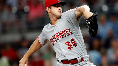 Cincinnati Reds starting pitcher Tyler Mahle (30) works in the first inning of a baseball game against he Atlanta Braves, Monday, June 25, 2018, in Atlanta. The Braves won 5-4 in 11 innings. (AP Photo/John Bazemore)