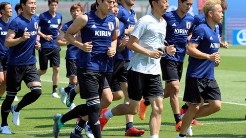 Players warm up during a training session of Japan national team at the 2018 soccer World Cup in Kazan, Russia, Tuesday, June 26, 2018. (AP Photo/Eugene Hoshiko)