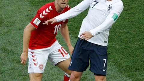 Denmark's Christian Eriksen, left, and France's Antoine Griezmann challenge for the ball during the group C match between Denmark and France at the 2018 soccer World Cup at the Luzhniki Stadium in Moscow, Russia, Tuesday, June 26, 2018. (AP Photo/Victor R. Caivano)