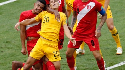 Peru's Anderson Santamaria, left, Peru's Pedro Aquino, second left, and Australia's Trent Sainsbury jump for the ball during the group C match between Australia and Peru, at the 2018 soccer World Cup in the Fisht Stadium in Sochi, Russia, Tuesday, June 26, 2018. (AP Photo/Efrem Lukatsky)