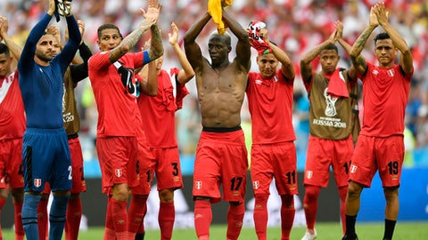 Peruvian players applaud after winning 2-0 during the group C match between Australia and Peru, at the 2018 soccer World Cup in the Fisht Stadium in Sochi, Russia, Tuesday, June 26, 2018. (AP Photo/Martin Meissner)