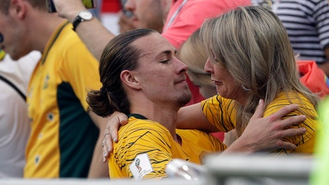 A crying woman embraces Australia's Jackson Irvine at the end of the group C match between Australia and Peru, at the 2018 soccer World Cup in the Fisht Stadium in Sochi, Russia, Tuesday, June 26, 2018. (AP Photo/Gregorio Borgia)