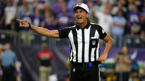 Referee Gene Steratore makes a call during the first half of an NFL football game between the Minnesota Vikings and the New Orleans Saints, Monday, Sept. 11, 2017, in Minneapolis. (AP Photo/Bruce Kluckhohn)