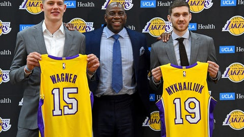 EL SEGUNDO, CA - JUNE 26:  Magic Johnson, the Los Angeles Lakers president of basketball operations, stands with the team's 2018 NBA draft picks Moritz Wagner and Sviatoslav Mykhailiuk during an introductory press conference at the UCLA Health Training Center on June 26, 2018 in El Segundo, California.  Wagner was chosen with the 25th overall pick and Mykhailiuk with the 47th pick.  TO USER: User expressly acknowledges and agrees that, by downloading and/or using this Photograph, User is consenting to the terms and conditions of the Getty Images License Agreement.  (Photo by Jayne Kamin-Oncea/Getty Images)