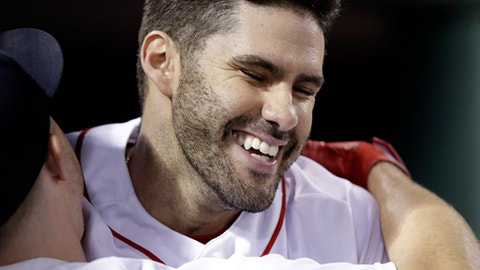 Boston Red Sox's J.D. Martinez smiles as he is embraced by Brock Holt after his solo home run during the sixth inning against the Los Angeles Angels in a baseball game at Fenway Park in Boston, Tuesday, June 26, 2018. (AP Photo/Charles Krupa)