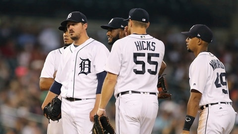 Detroit Tigers starting pitcher Blaine Hardy, left, stands on the mound before being relieved during the fifth inning of the team's baseball game against the Oakland Athletics, Tuesday, June 26, 2018, in Detroit. (AP Photo/Carlos Osorio)