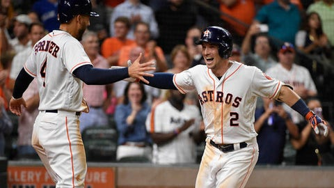 Houston Astros' Alex Bregman (2) celebrates his two-run home run off Toronto Blue Jays relief pitcher Tim Mayza with George Springer during the eighth inning of a baseball game Tuesday, June 26, 2018, in Houston. (AP Photo/Eric Christian Smith)